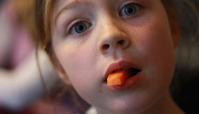 kid eating carrot