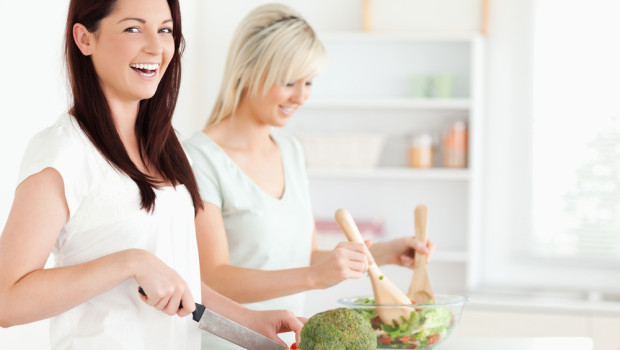 women laughing with salad