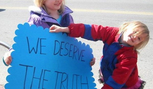 'We Deserve the Truth' Sign
