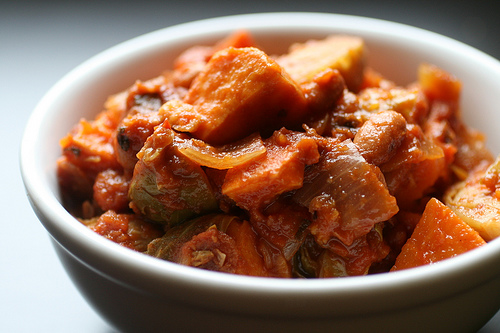 Hearty sweet potatoes are the perfect partner to bitter Brussels sprouts in this unusual chili recipe.