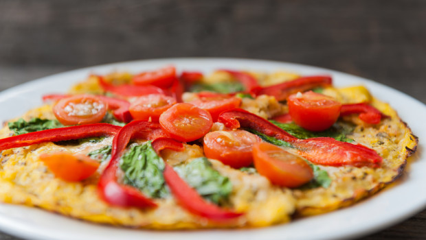 Vegan Cauliflower Pizza Crust Recipe - Whether you're looking to cut the carbs or just mix things up on the menu, this vegan cauliflower pizza crust recipe is just the thing!