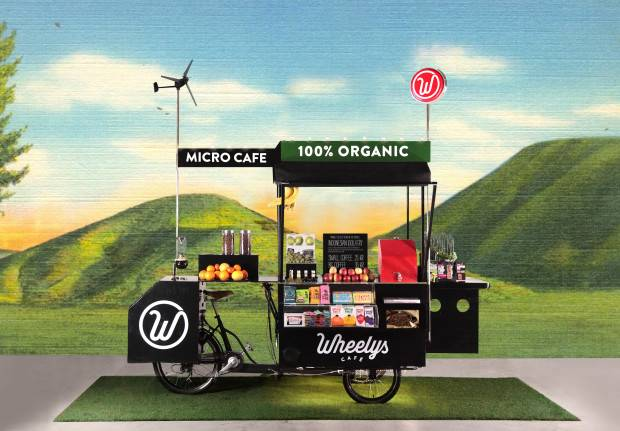 Who wouldn't want to buy coffee at a solar powered bike cafe that cleans the air around it and recycles coffee grounds into flowers?